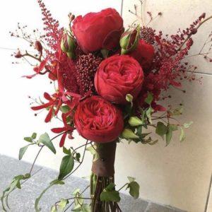 Букет невесты из пионовидных роз цвета марсала